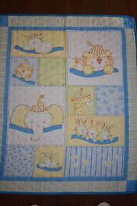 Blue Sleeping Animals cot quilt