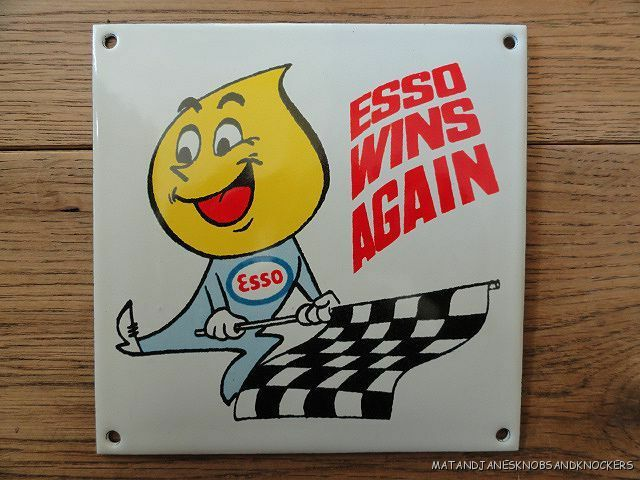 SUPERB VINTAGE ESSO WINS AGAIN ENAMEL METAL SIGN PLAQUE