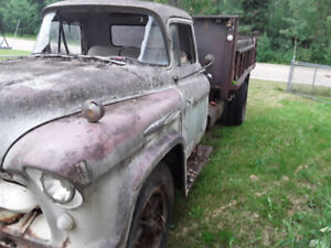 1957 Chevy 2ton with tilt bed with dump box, spare tire.Complete