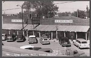 1950-RPPC-WALL-SOUTH-DAKOTA-WALL-DRUG-STORE-SNOBOY-ADVERTISING-ON-CAR-POSTCARD