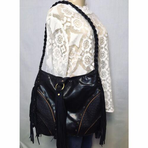 A large tassel pendant leatherette black
