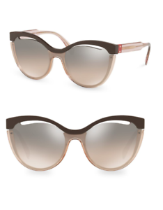 c27f43dfb82 Miu Miu SMU 01T DHO-4P0 Sunglasses Transparent Pink Frame Brown ...