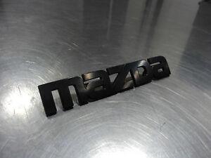 MAZDA RX-7 1984-1985 NEW OEM REAR BLACK MAZDA LOGO EMBLEM BADGE F023-51-780