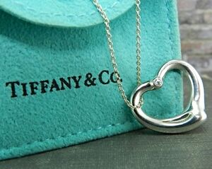 Tiffany co elsa peretti open heart pendant w diamond ebay image is loading tiffany amp co elsa peretti open heart pendant aloadofball Image collections