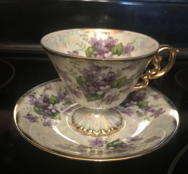 COLLECTIBLE ENESCO FEBRUARY VIOLET VINTAGE FOOTED TEACUP & SAUCER LUSTER