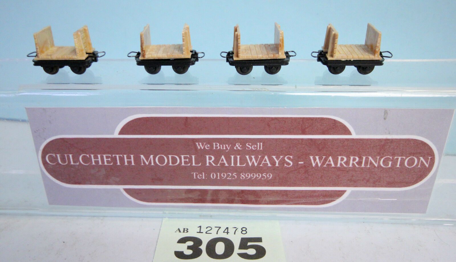 LILIPUT '009' RAKE OF 4X QUARRY 4 WHEEL WAGONS UNBOXED