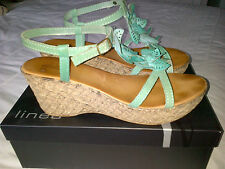 Turquoise flowery sandals size 7 by Linea