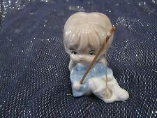 Very pretty ceramic figure of a girl with a fishing rod approx 3½ ins tall
