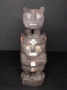 Chimu or Chancay Pre Columbian style wood figure with inlay shell