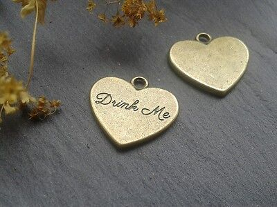 Antique Bronze Drink Me Eat me Heart Charms Alice in Wonderland Tags Pendants