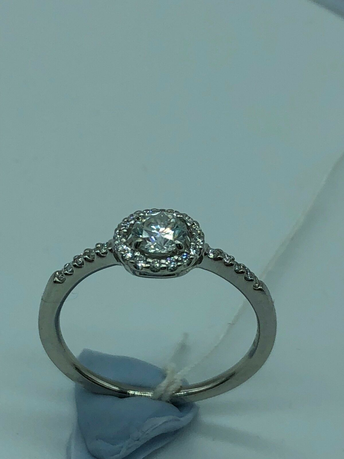 Diamond engagement ring with halo and diamond shoulders