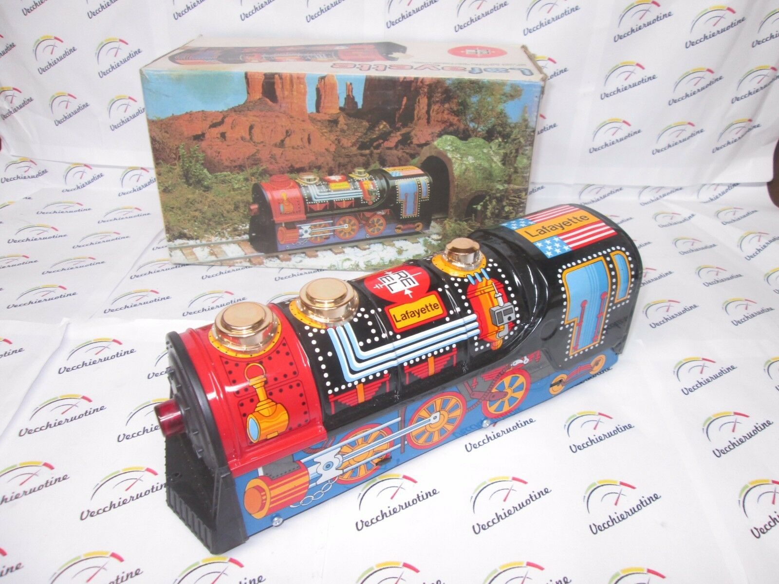 Reel LOCOMOTIVA IN LATTA a batteria mistery BUMP AND GO battery operated tin toy