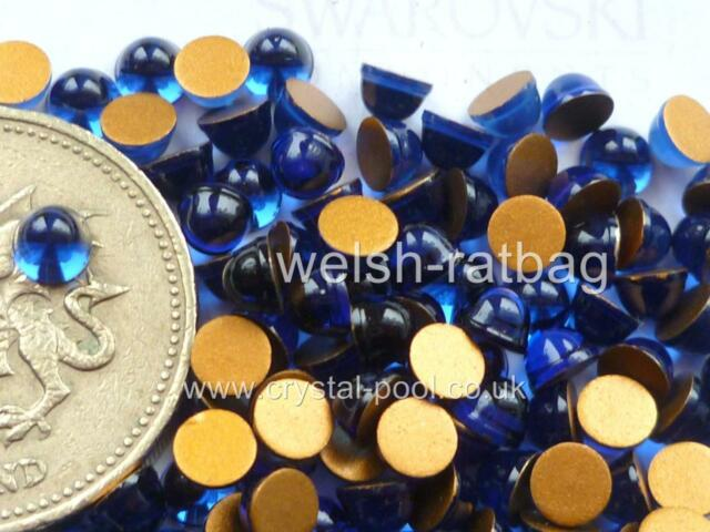 24 x Swarovski 4mm Dark Sapphire gold-foiled high-dome #2099/4 cabochons