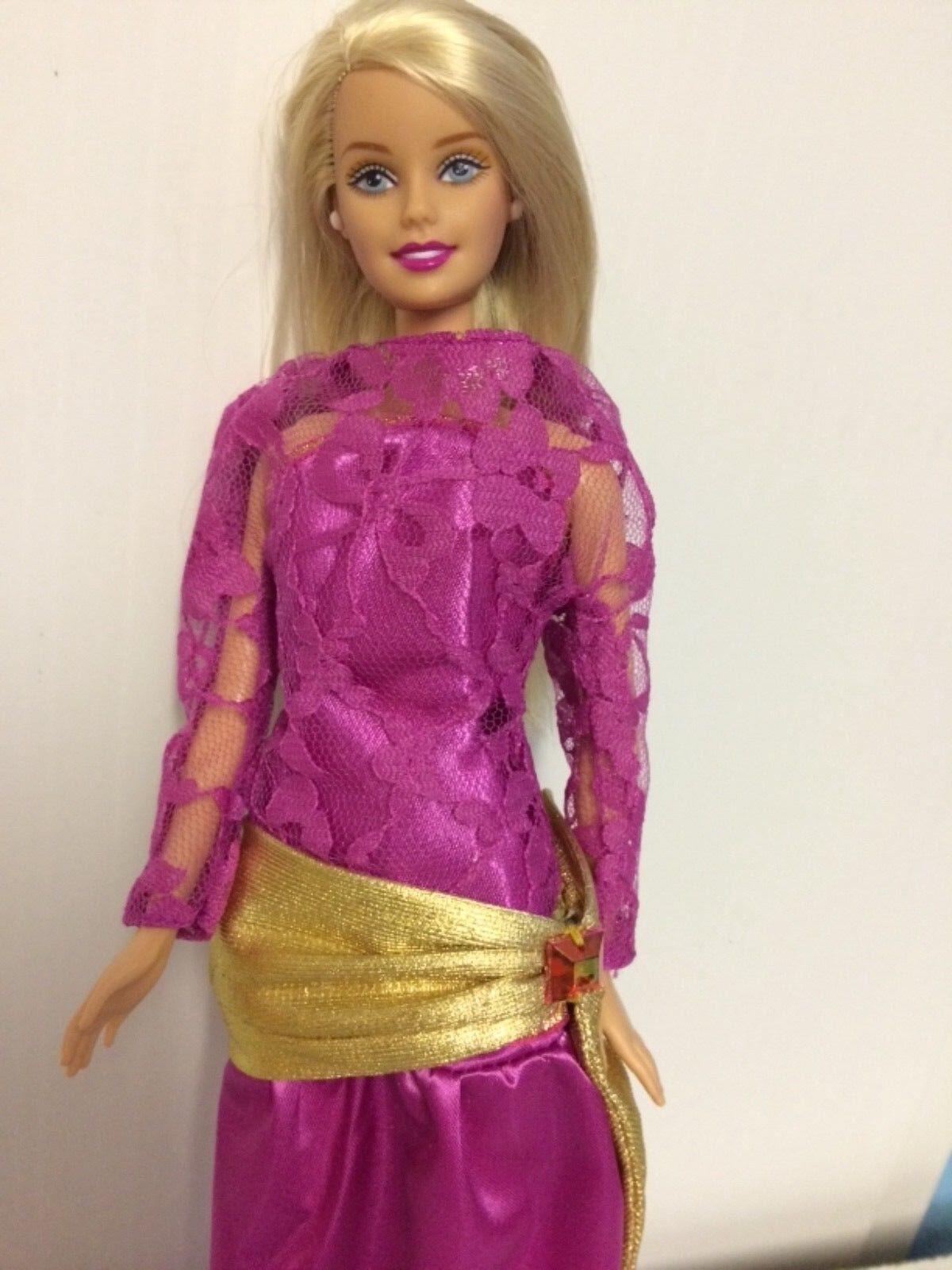 Barbie doll (playline) ROTressed in Oscar de la renta gown