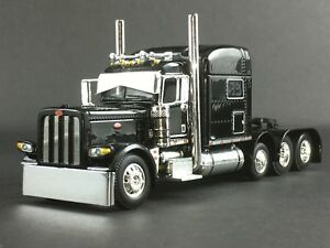 "1/64 DCP BLACK 389 PETERBILT TRI-AXLE W/ 70"" SLEEPER"