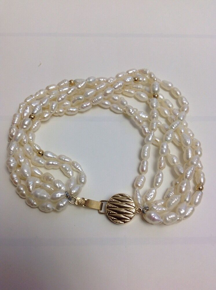 VINTAGE MULTI-STRAND GENUINE PEARL BRACELET  WITH 14KT YELLOW gold