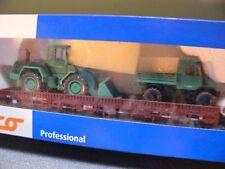 1/87 Wiking Radlader+Unimog Schwarz Bau + Roco Güterwagen 47848