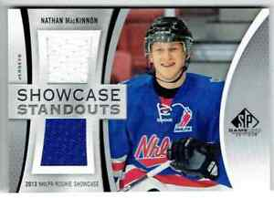 2019-20-SP-GAME-USED-SHOWCASE-STANDOUTS-NATHAN-MACKINNON-DUAL-JERSEYS-2-COLORS
