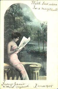 Girl-on-terrace-Christmas-card-1905-postcard-antique-colour-printed