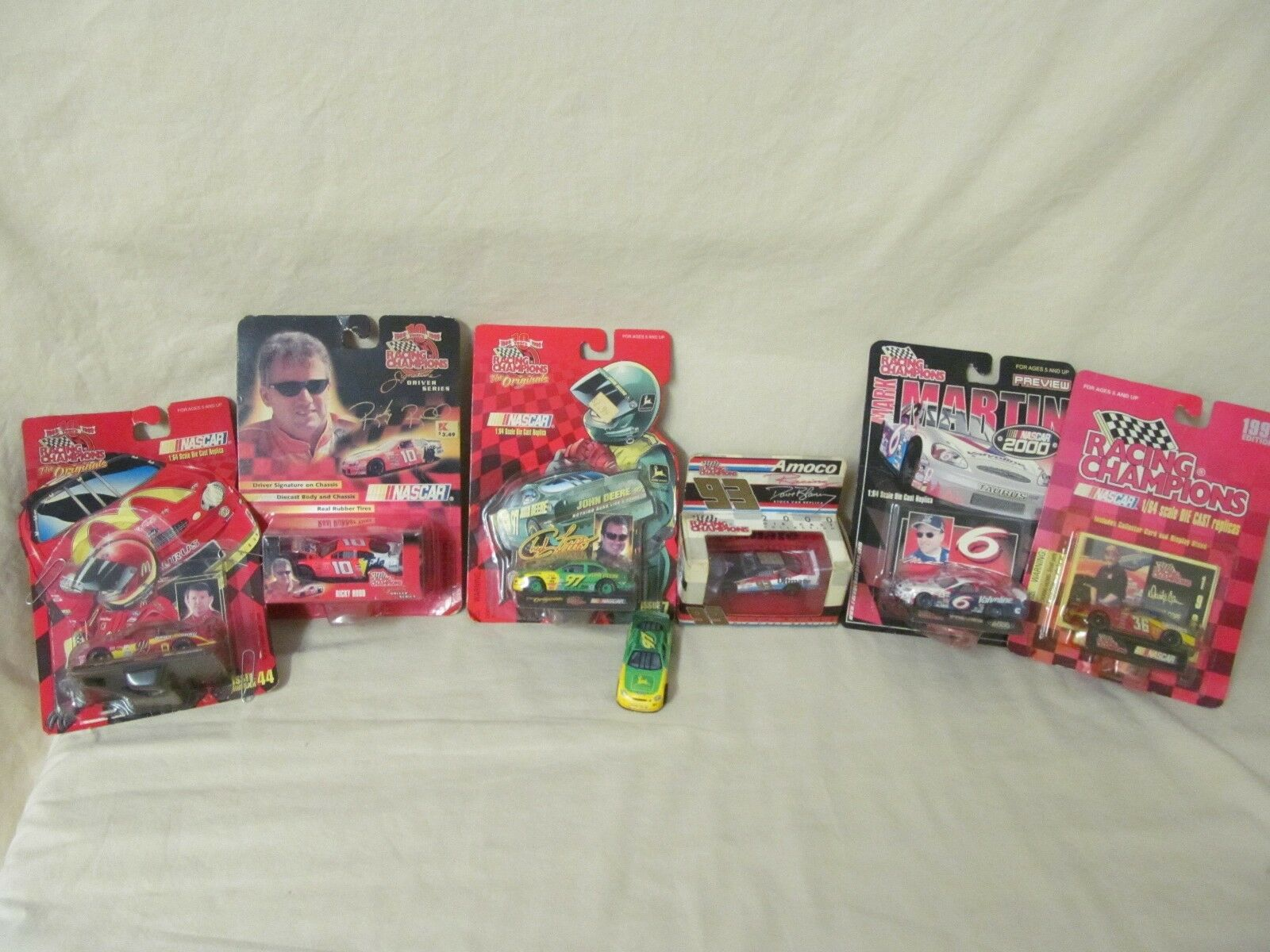 NASCAR 6 Assorted Racing Champions 1 64 Scale w original boxes & 1 loose car