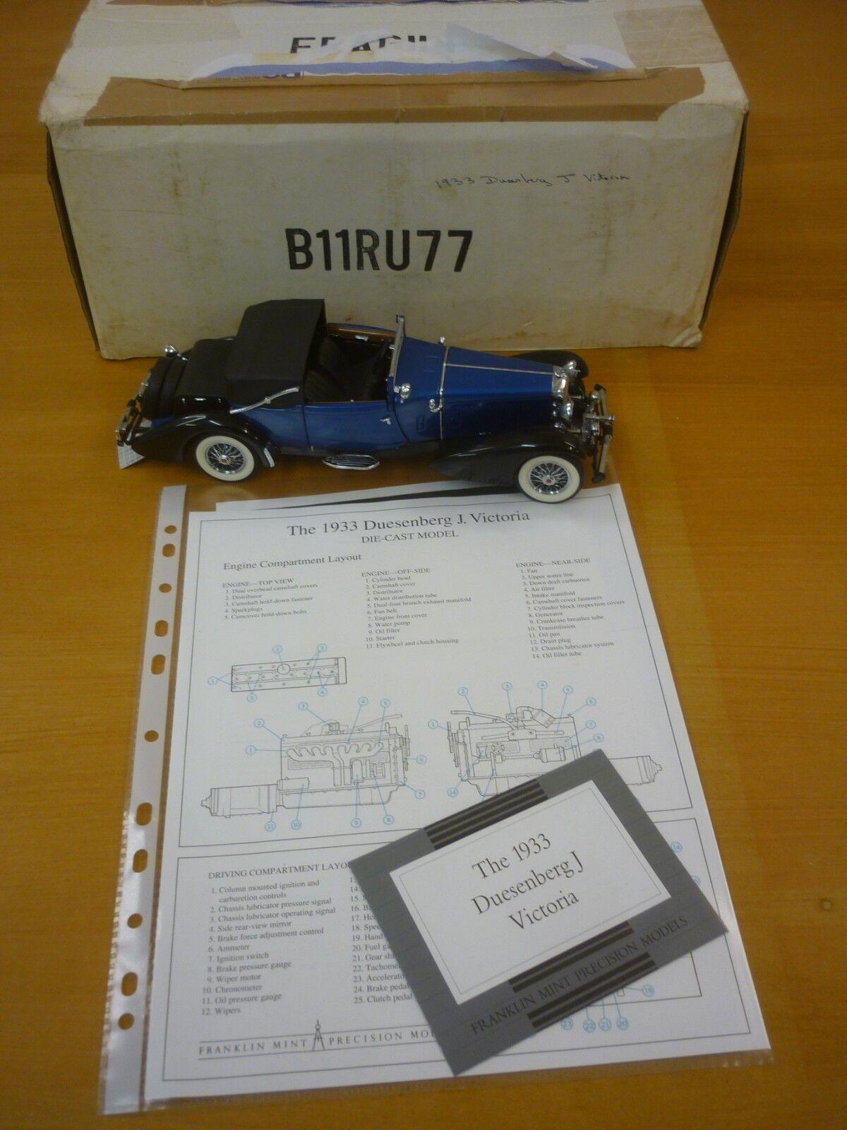 Un Franklin Mint 1933 Duesenberg J victoria, en caja con papeles.