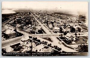 Glendive-Montana-Birdseye-Residential-District-Homes-Stores-on-Street-1923-RPPC