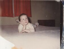 Old Vintage Polaroid Photograph Little Boy on Bed Looking Up and Pondering