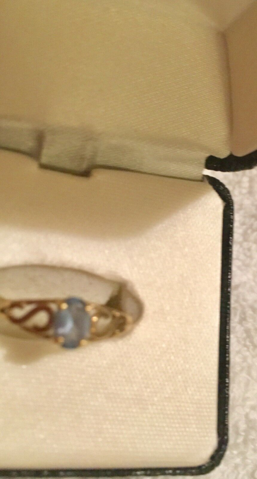 Ladies 10K gold Ring with Light blueee Stone...size 6
