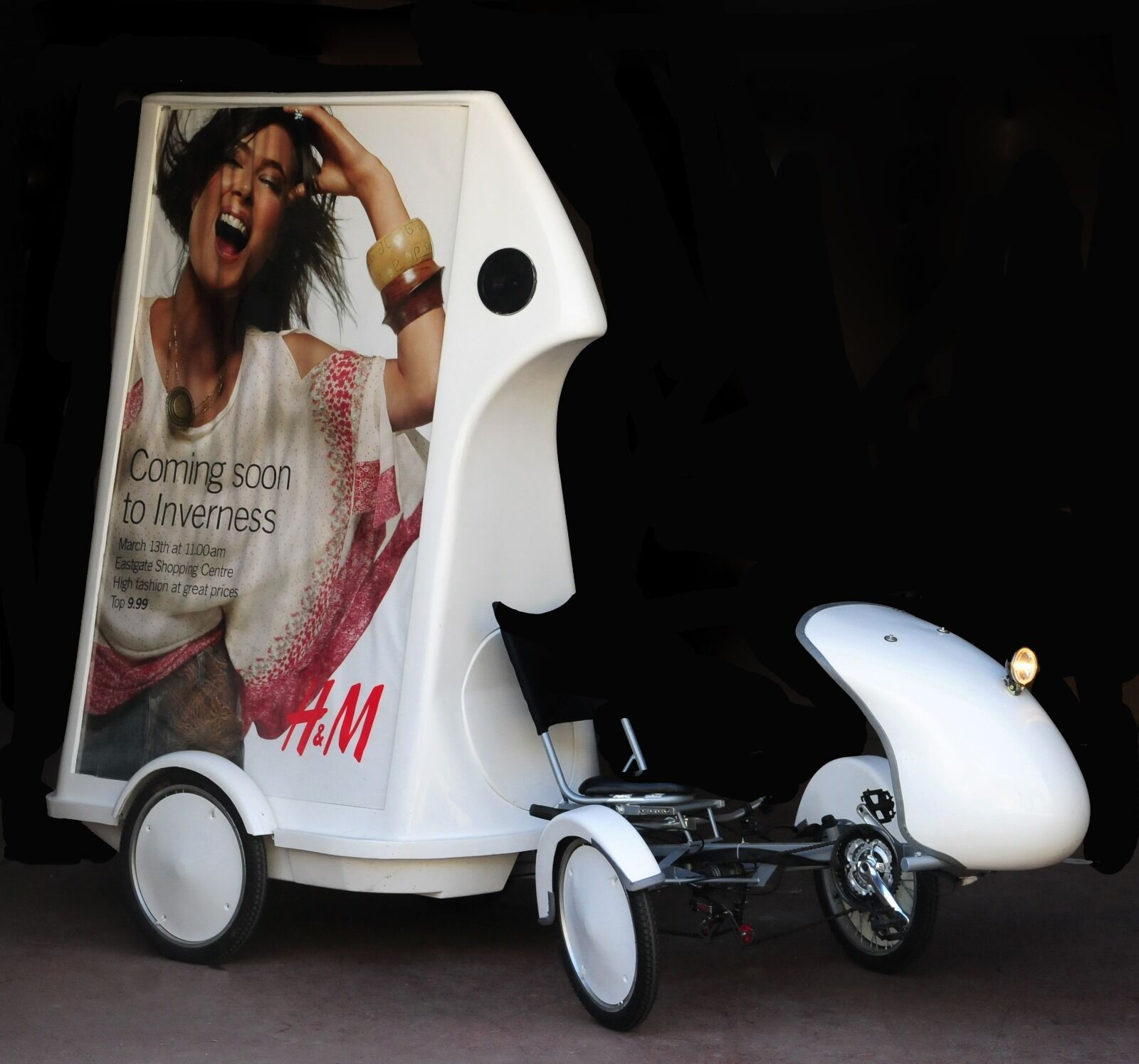Adbikes with back-lit posters and integrated sound systems, interior storage.
