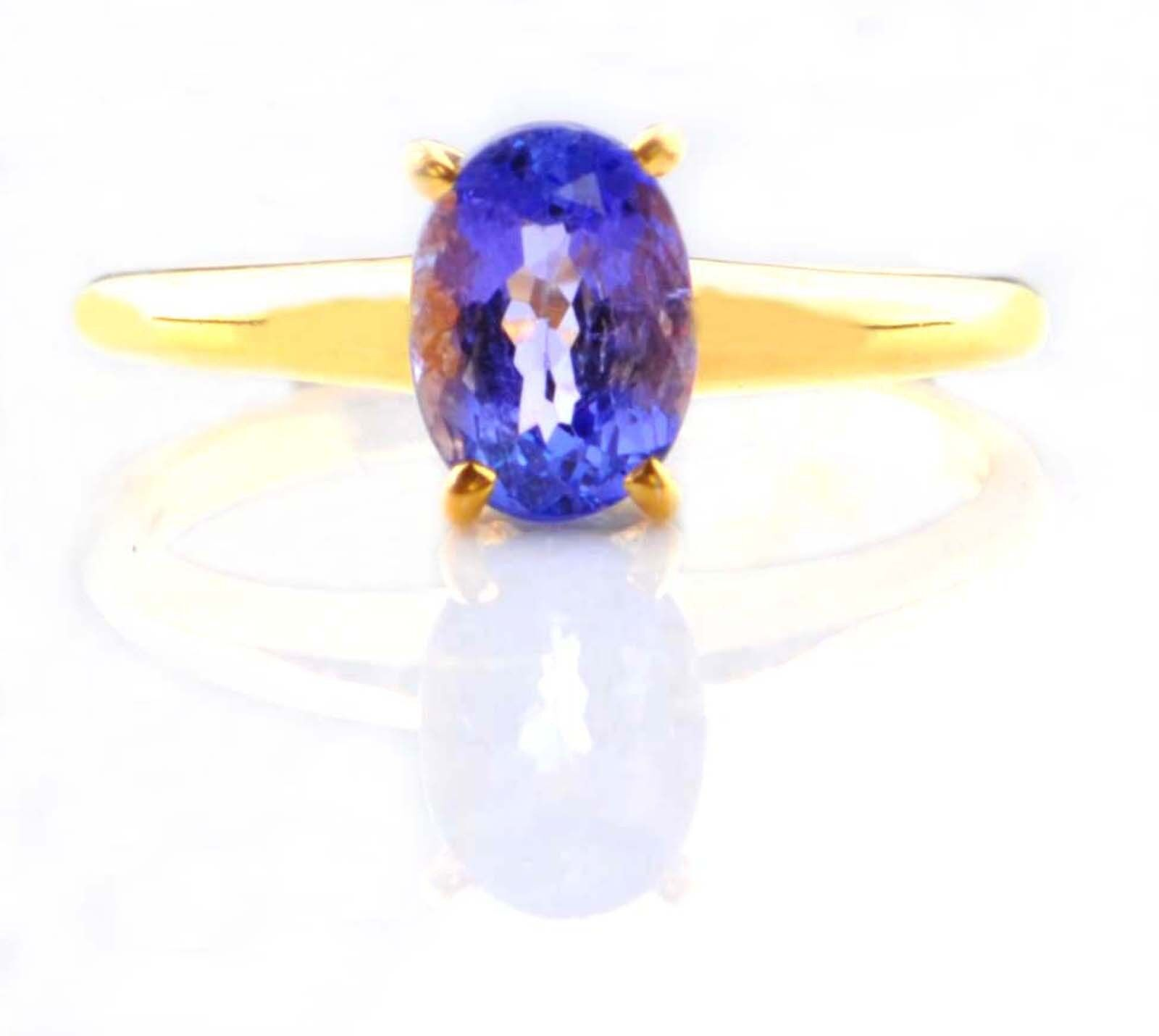 Natural bluee Tanzanite 1.70 Carat Oval Shape 14KT Yellow gold Solitaire Ring