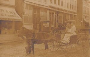 RPPC-REAL-PHOTO-POSTCARD-NAPPANEE-INDIANA-STREET-SCENE-HARTMAN-BROS-RARE-BUGGY