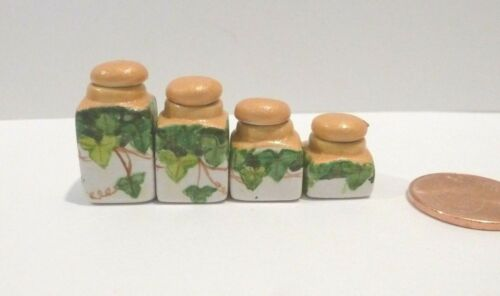 MINIATURE CANISTER SET WITH A GRAPEVINE DESIGN   4 piece