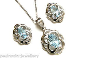 6b1f7f108 Sterling Silver Blue Topaz Celtic Pendant and Earring Set Gift Boxed ...
