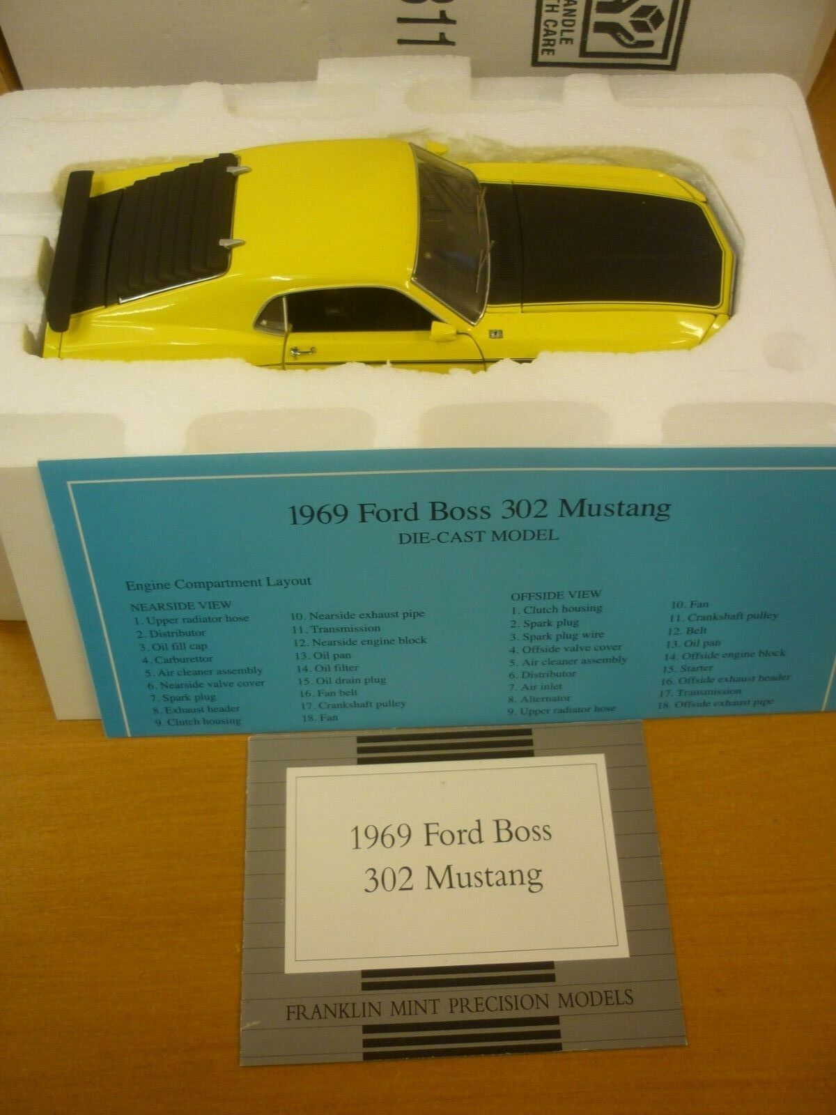 Franklin mint Scale model of a 1969 Ford BOSS 302 mustang, paperwork, boxed