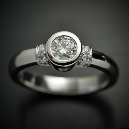 0.60 Ct Near White Solitaire Round Moissanite Engagement Ring In 10K White gold