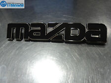 Mazda RX-7 1979-1980 New OEM Front Black Mazda Logo Emblem Bardge 8871-51-771B