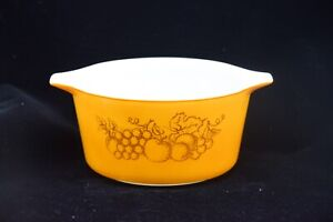 Collectible, Pyrex casserole dish, light orange, fruit pictured on one side in b