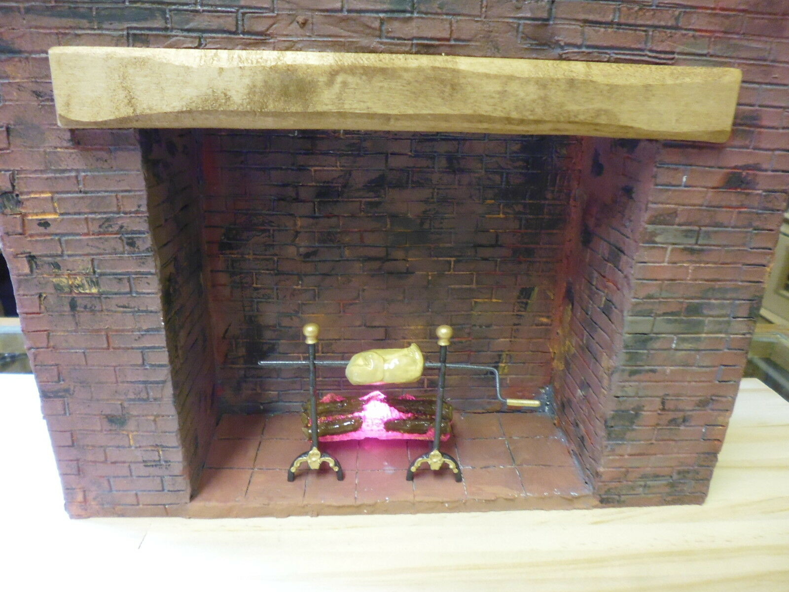1 12 Dolls House   Fireplace surround with Log Fire. Brick.  Lights Up