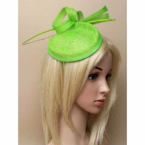 Lime green fascinator alice hair band in sinamay with loops and wooden tendril