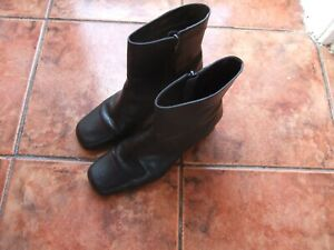 Used black leather ankle boots from