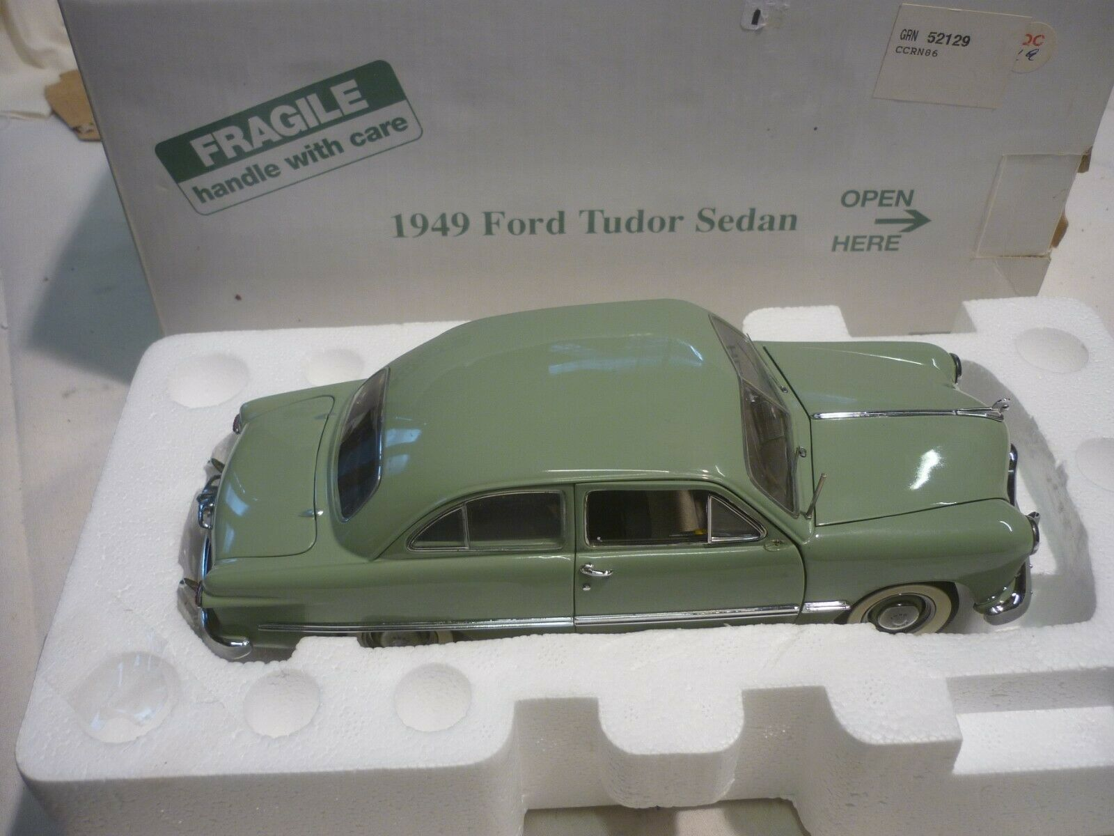 A Danbury mint of a scale model of a 1949 Ford Tudor sedan, Boxed
