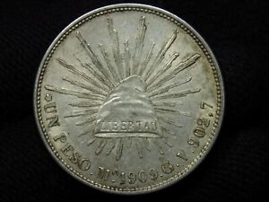 1909 Mexico MO GU Un Peso Mexico City LOTS OF LUSTER