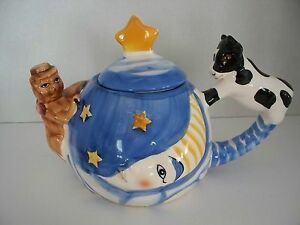 nursery rhyme cow jumped over the moon theme teapot cat