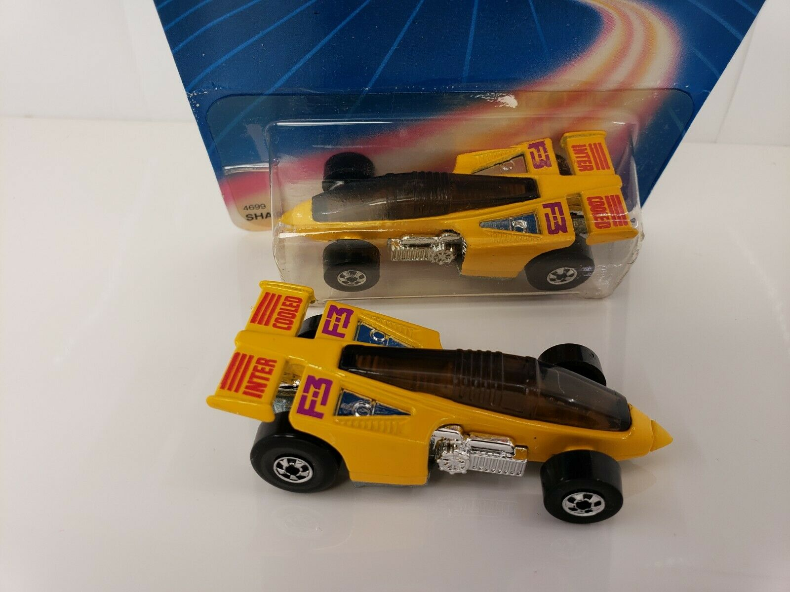 HOTWHEELS 1987 YELLOW SHADOW JET UNPUNCHED CARD, WITH TWO MINT CARS ,KIDSTOYZ®