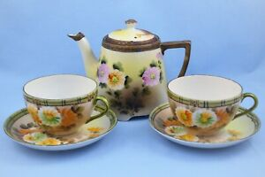 ANTIQUE HAND PAINTED NIPPON JAPAN TEAPOT, 2 CUPS AND 2 SAUCERS SET FLORAL