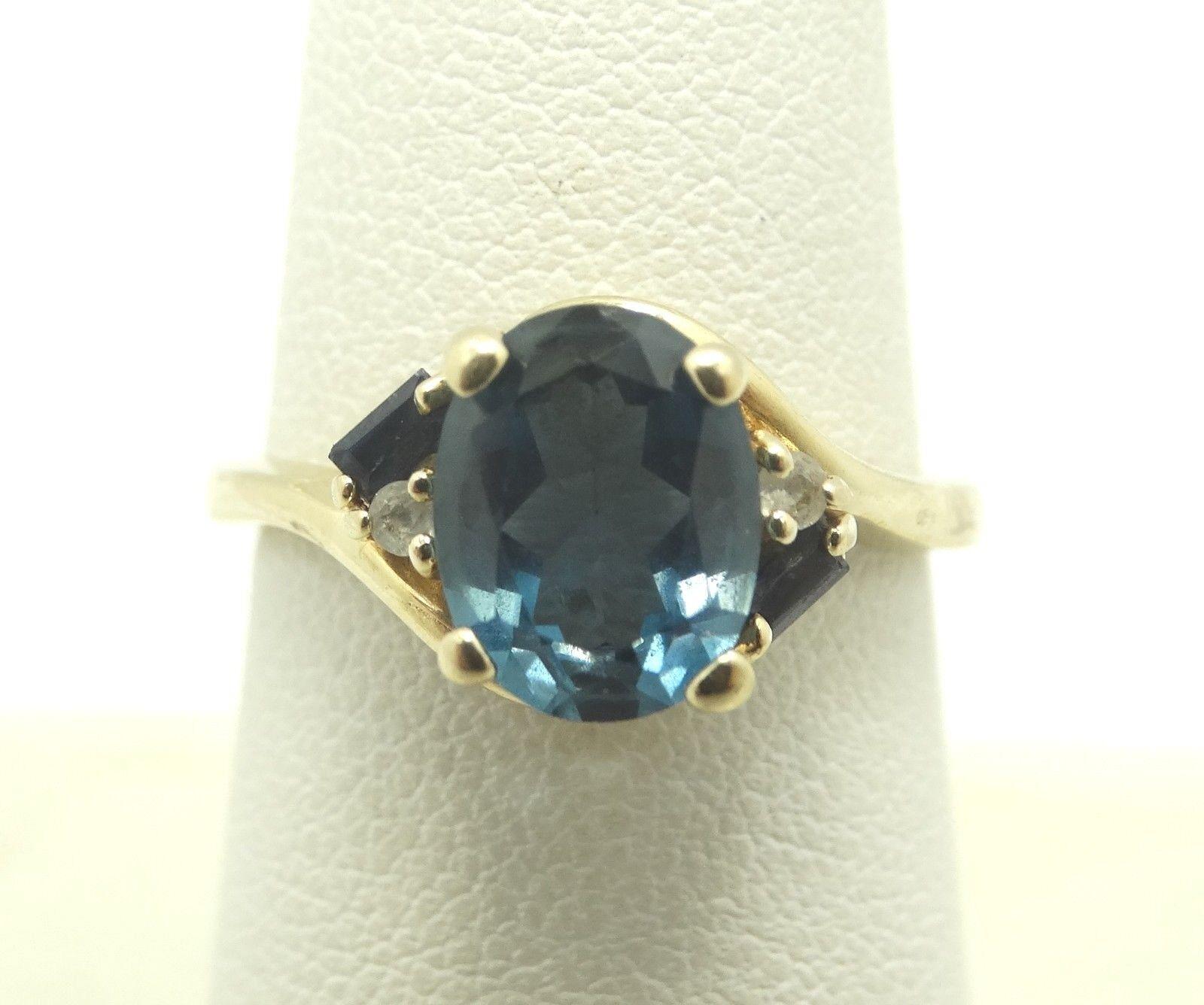 Stunning 14K Y gold Diamond 9mm Oval London blueee Topaz Ring Size 7 3.8g D5354