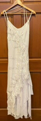 white sequin with floral patter spaghetti strap dr