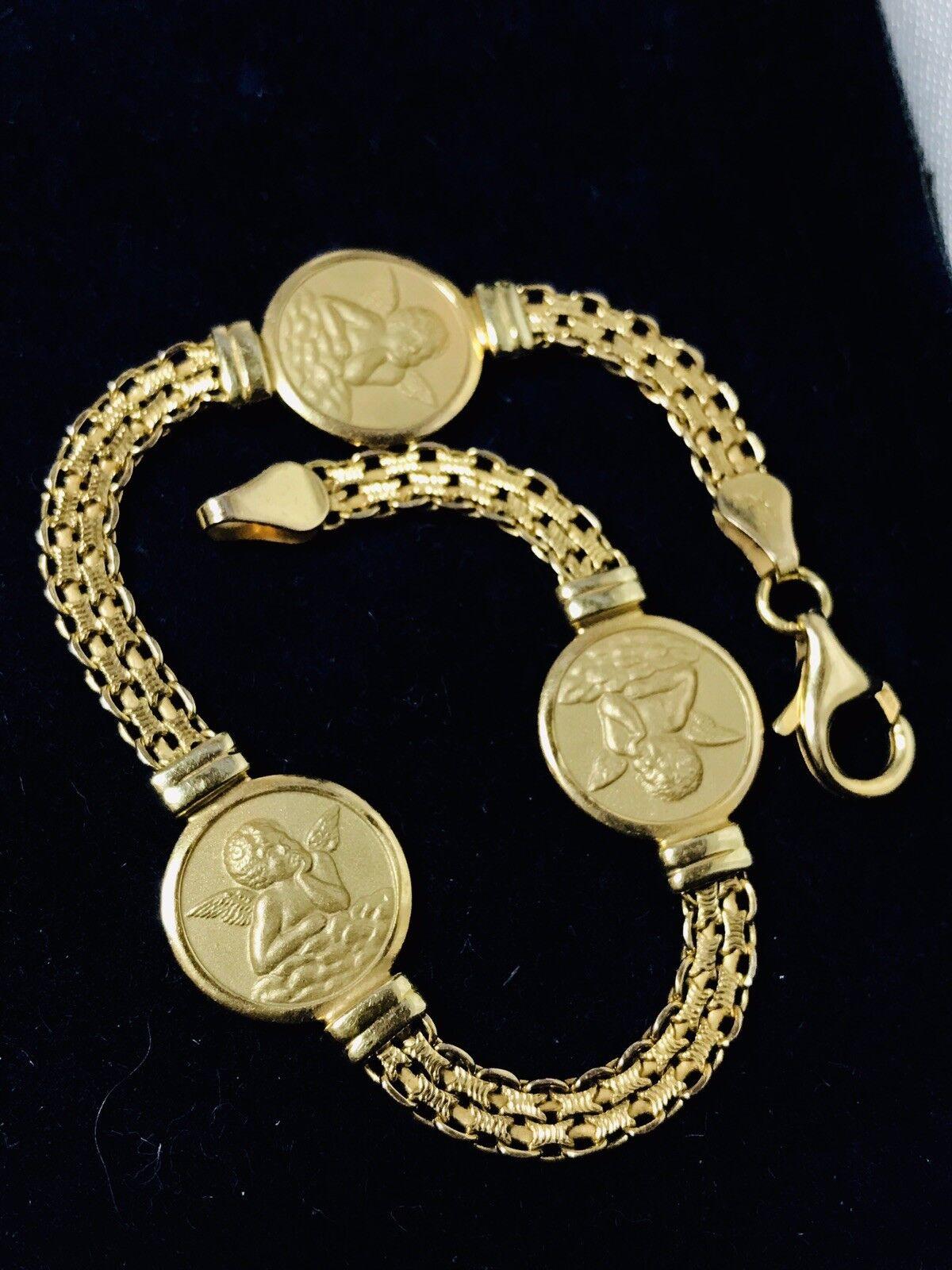 14k Yellow gold Cherub Charm Bracelet        12.4 Grams
