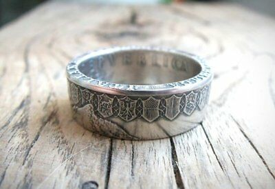 ring corner Ring 500 Lei Romania coin in silver set with a sapphire