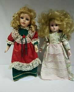 Two 17 Inch Tall Collectible Dolls with Display Stand